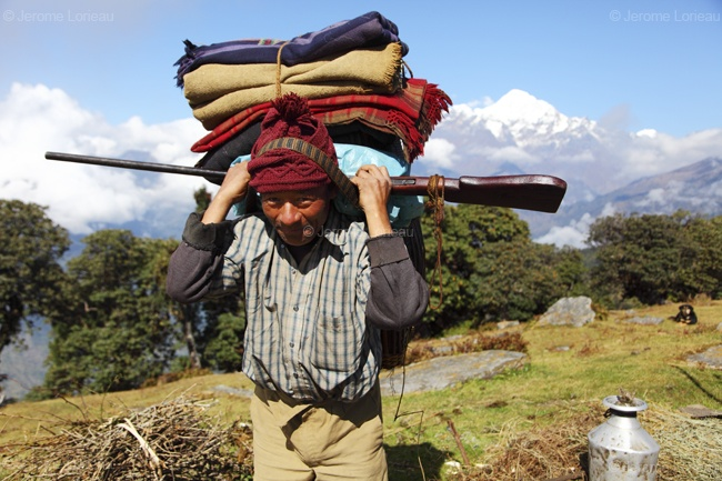 Shepherd and his shotgun in order to protect goats from wild animals, Gupsi Dada, Gorkha district, Nepal
