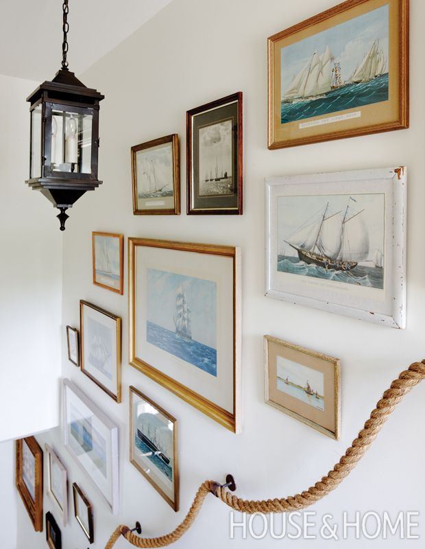 Nautical-themed oil paintings, boat etchings and photographs become a curated collection. | Photographer: Janet Kimber Designer: Phillip Mitchell