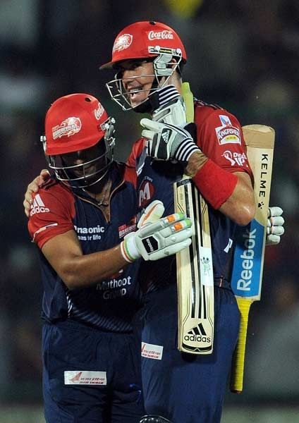 Delhi Daredevils batsman Kevin Pietersen (R) is congratulated by teammate Yogesh Nagar during the IPL Twenty20 cricket match between Deccan Chargers and Delhi Daredevils at The Feroz Shah Kotla stadium in New Delhi on April 19, 2012. #IPL #DelhiDareDevils #COYD