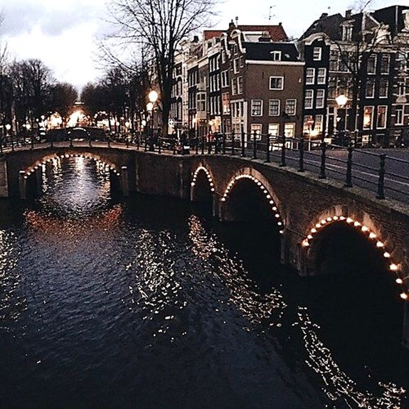 NETHERLANDS – Grachtengordel neighbourhood of the Canal Ring district, Amsterdam, Noord-Holland. On the left is the canal along Reguliersgracht and on the right is the canal along Keizersgracht. The third building to the right from the corner is The Blue Stairs bed & breakfast at Keizersgracht 665. https://www.google.ca/maps/place/The+Blue+Stairs/@52.3636957,4.8941755,17z/data=!3m1!4b1!4m5!3m4!1s0x47c60994e36c8e01:0xa76f43e0e5343ee3!8m2!3d52.3636957!4d4.8963642