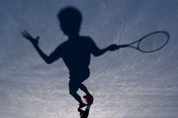 Image was rotated from its original perspective.) Rigele Te of China in action in his match against Mate Valkusz of Hungary during the Australian Open 2015 Junior Championships at Melbourne Park on January 24, 2015 in Melbourne, Australia. (January 23, 2015 - Source: Michael Dodge/Getty Images AsiaPac)