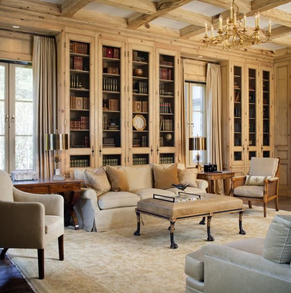 bookcases carry the ceiling beams beautifully