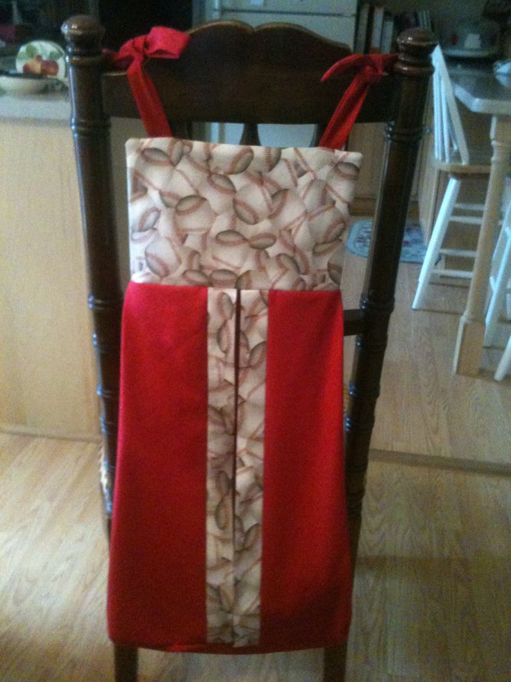 Baseball diaper stacker made to match baby quilt and curtains in baby room.