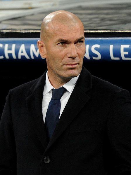 Zinedine Zidane Photos Photos - Zinedine Zidane, Manager of Real Madrid looks on during the UEFA Champions League Group F match between Real Madrid CF and Borussia Dortmund at the Bernabeu on December 7, 2016 in Madrid, Spain. - Real Madrid CF v Borussia Dortmund - UEFA Champions League