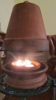 HEATING YOUR HOUSE WITH CLAY POTS. Would be very handy if there was a power outage in the winter!