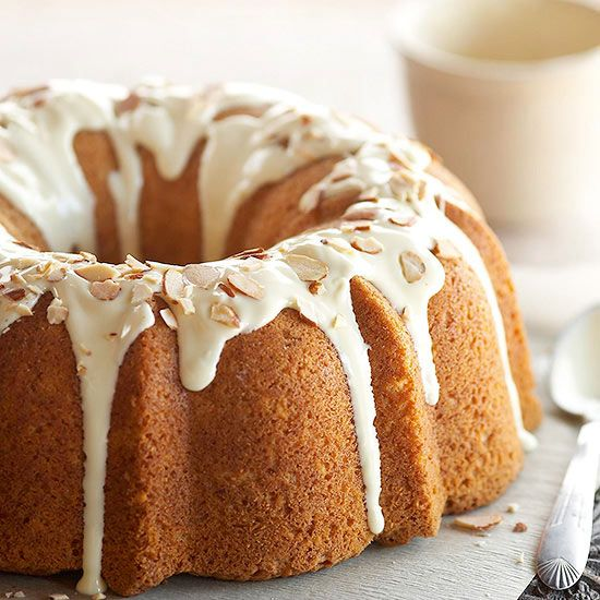 White Chocolate and Almond Pound Cake This elegantly sculpted dessert recipe is baked in a fluted tube pan and topped with a white chocolate glaze and toasted almonds before serving.