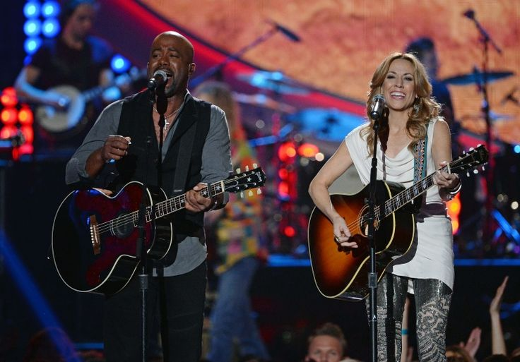 "Crank up the ""Wagon Wheel."" Darius Rucker and Sheryl Crow perform Rucker's hit during a performance on the 2013 American Country Awards on Dec. 10 in Las VegasCrows Performing, American Country, Rucker Hit, Hit Stores, Music 2014, Darius Rucker, Country Awards, Holiday Music, Country Singers"