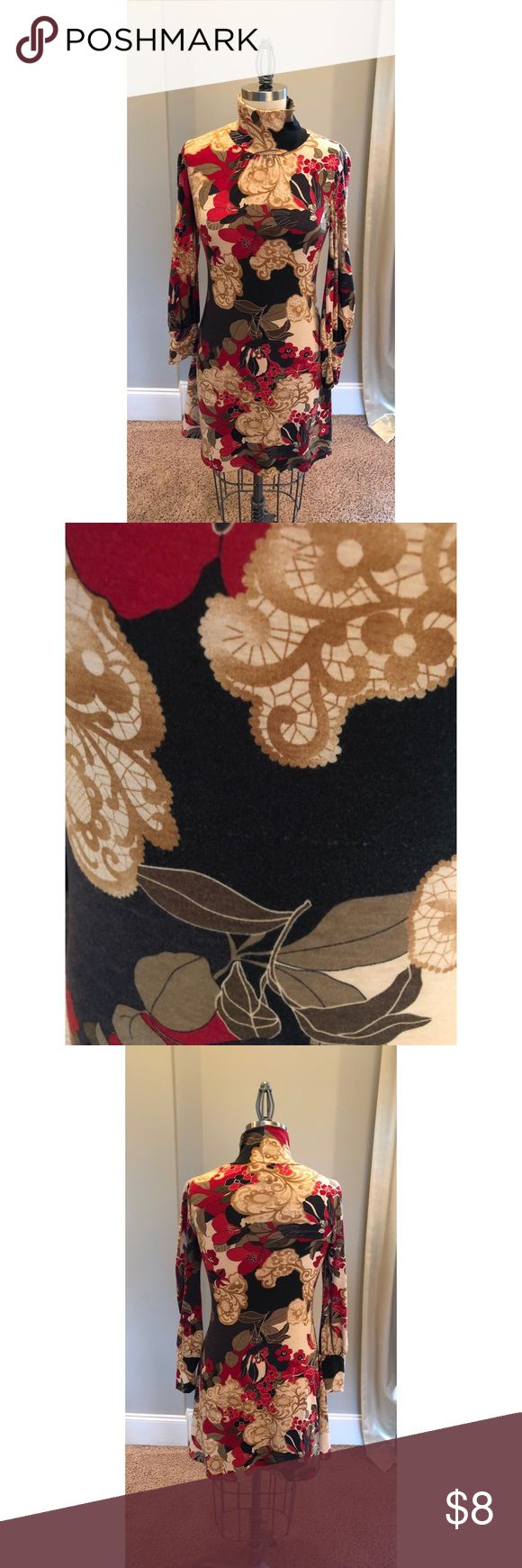 Red, Black, And Cream Long Sleeve Floral Dress Red, black, and cream long sleeve dress size medium. Floral and lace print. Wide wrist cuffs. Does have some piling. Other than that gently used and in good condition. Runs true to size. Beiza Dresses Mini