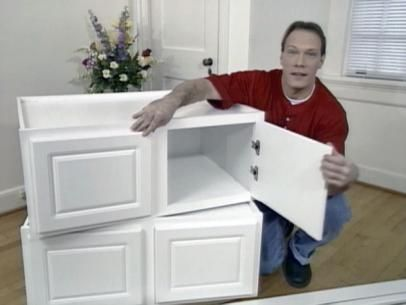 Buy long cabinets, turn on back so door lifts up like a storage bench/seat for mud room.