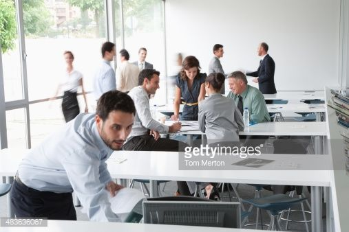 Stock Photo : Businesspeople working in corporate training facility