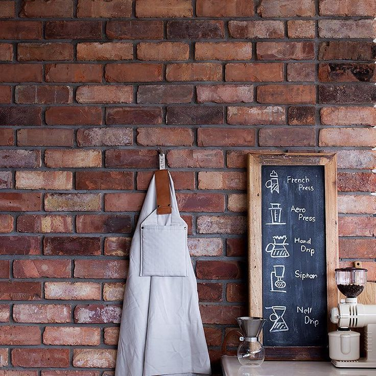 Our kitchen has the antique bricks. Love their shabby chic color. The apron hanging on the wall is designed and made by a talented man Motomasa Ishii @astruct. It won iF DESIGN AWARD 2015. I was really impressed by it as he had great deal of interest and love in his work. うちのキッチンの壁は古レンガ温かみのある色合いが気に入っています 壁に掛かっているのは知人の石井基公さん @astruct が製作したメンズエプロンドイツのデザイン賞iF DESIGN AWARD 2015を受賞したものなんとデザイン縫製等の全工程を全て一人でハンドメイドされています 思いのこもった手作りのモノってやはり美しいです