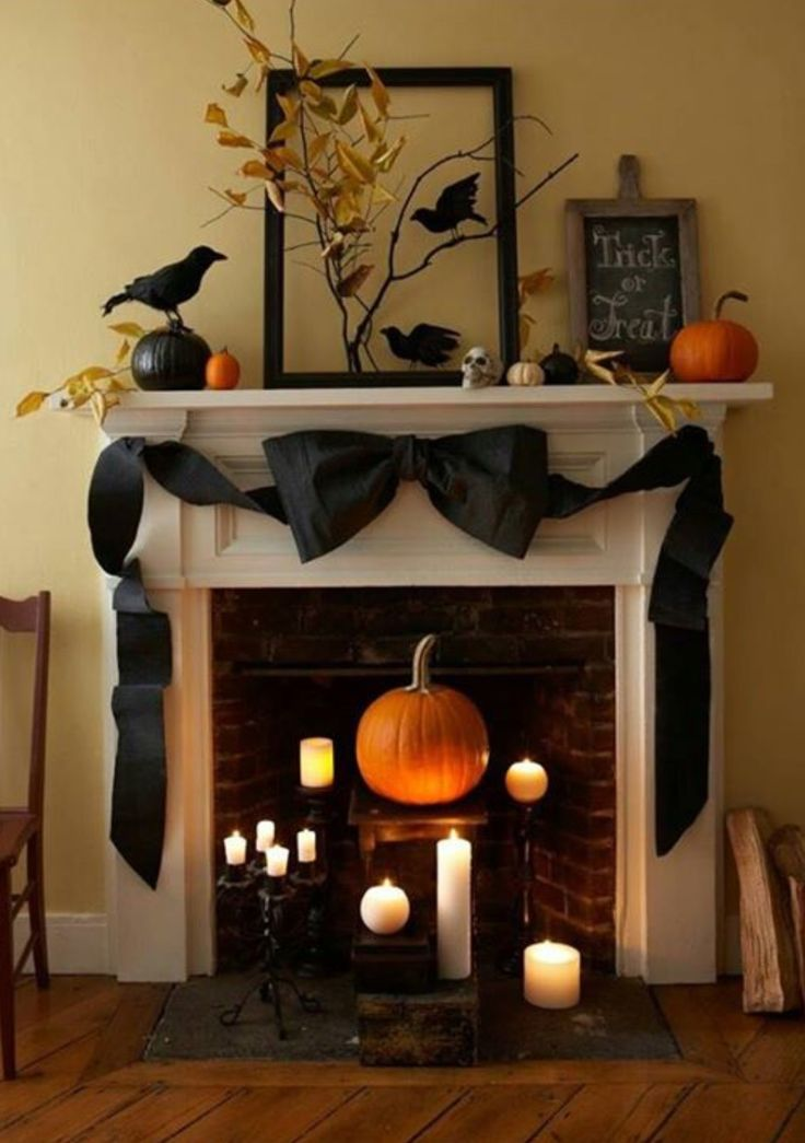 Love the different levels of candles and the pumpkin in the fireplace.