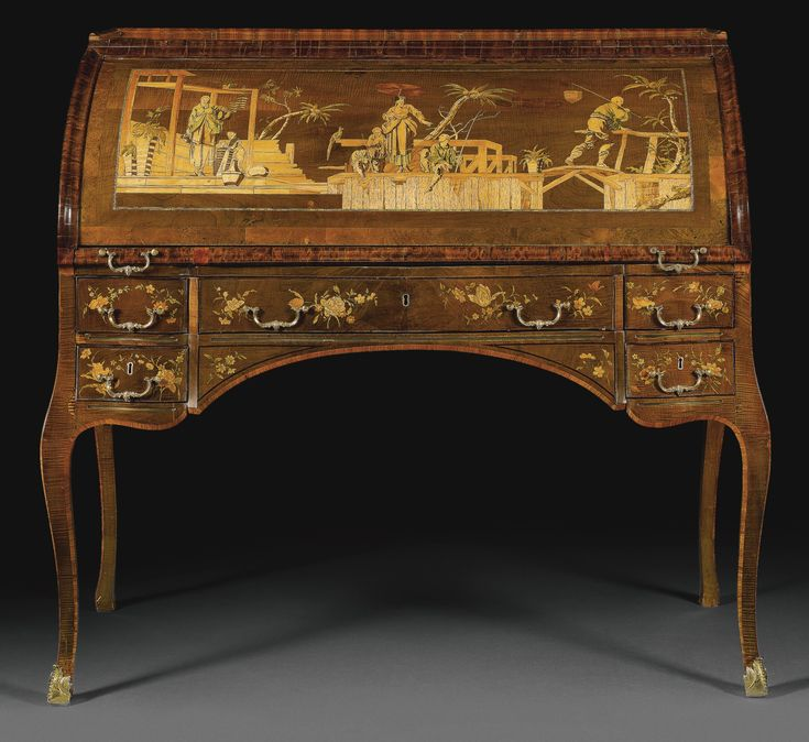A German gilt-bronze-and brass-mounted tulipwood, stained sycamore, burr wood, fruitwood, holly and marquetry cylinder bureau by David Roentgen (1743-1807), Neuwied, circa 1773-75