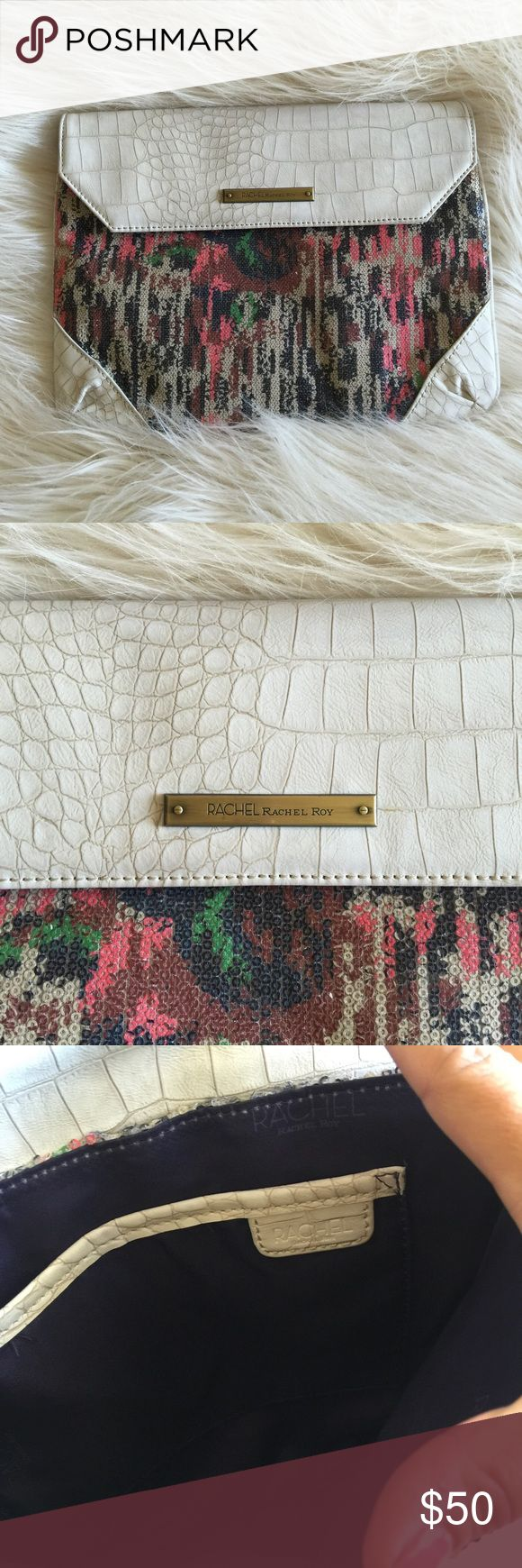 Rachael Roy Sequin & Snakeskin Multi Color Clutch Beautiful Rachel by Rachel Roy clutch bag. Multicolor sequins with alligator trim detailing. Vac features two nail looking pieces of hardware. Hardware is brass. Inside lines in deep purple with one pocket. RACHEL Rachel Roy Bags Clutches & Wristlets