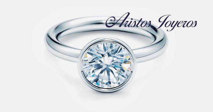 Elegante anillo solitario oro blanco 14kl con Diamante central en bisel!!
