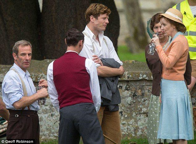 Taking a break: Grantchester stars Robson Green (left), James Norton (centre), Tessa Peake...