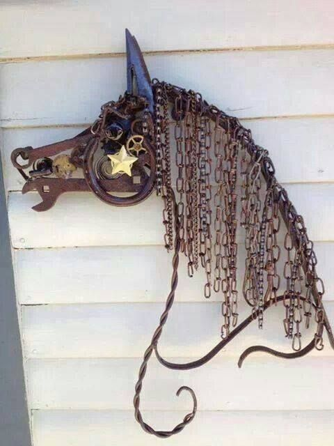 recycled tools chains and other metals are used here to create a spectacular horse profile!