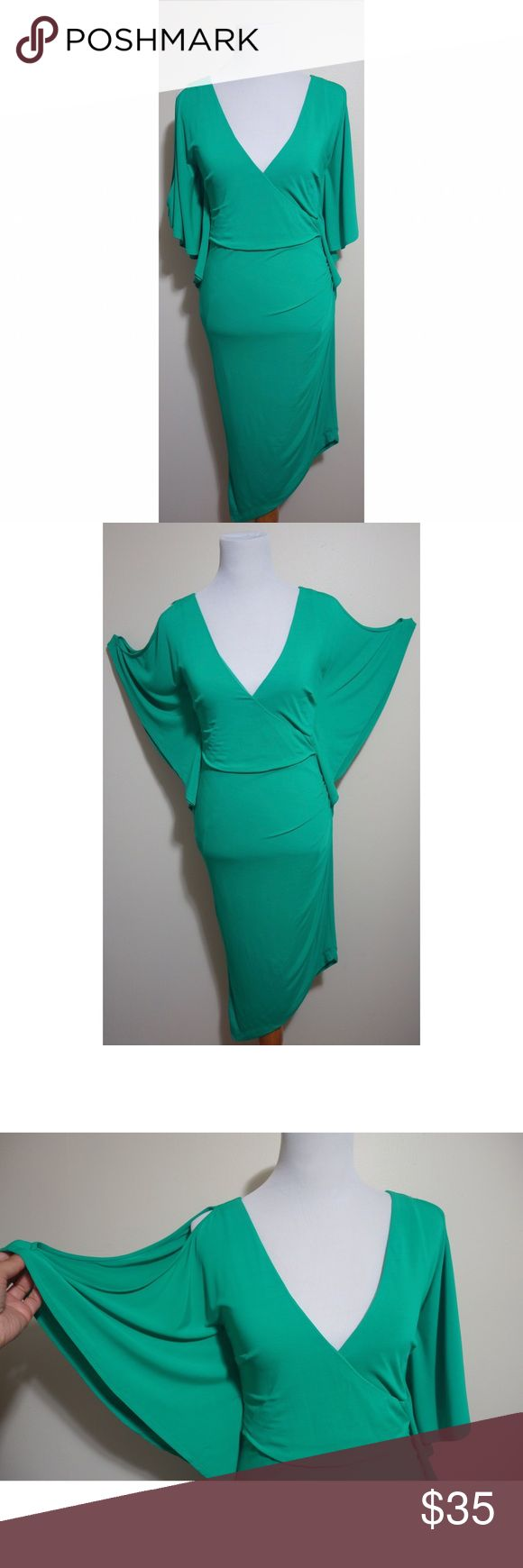 DeepV Cold Shoulder Batwing dress asymmetrical hem Bebe Deep V Cold Shoulder Batwing dress with asymmetrical hem and ruching .  Never worn .  Super sexy! bebe Dresses Midi