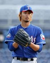 Starting pitcher Yu Darvish of the Texas Rangers pitches against the San Diego Padres during the spring training game.  http://www.fansedge.com/Yu-Darvish-Texas-Rangers-372012-_180708888_PD.html?social=pinterest_mlb_32312_darvish  #MLB  #Rangers