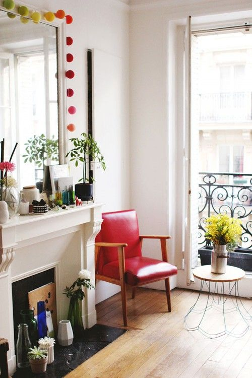 Design Sponge/ The lounge. The vintage red armchair was given to me by a friend. Table DIY was made with an old structure of a lamp. The col...
