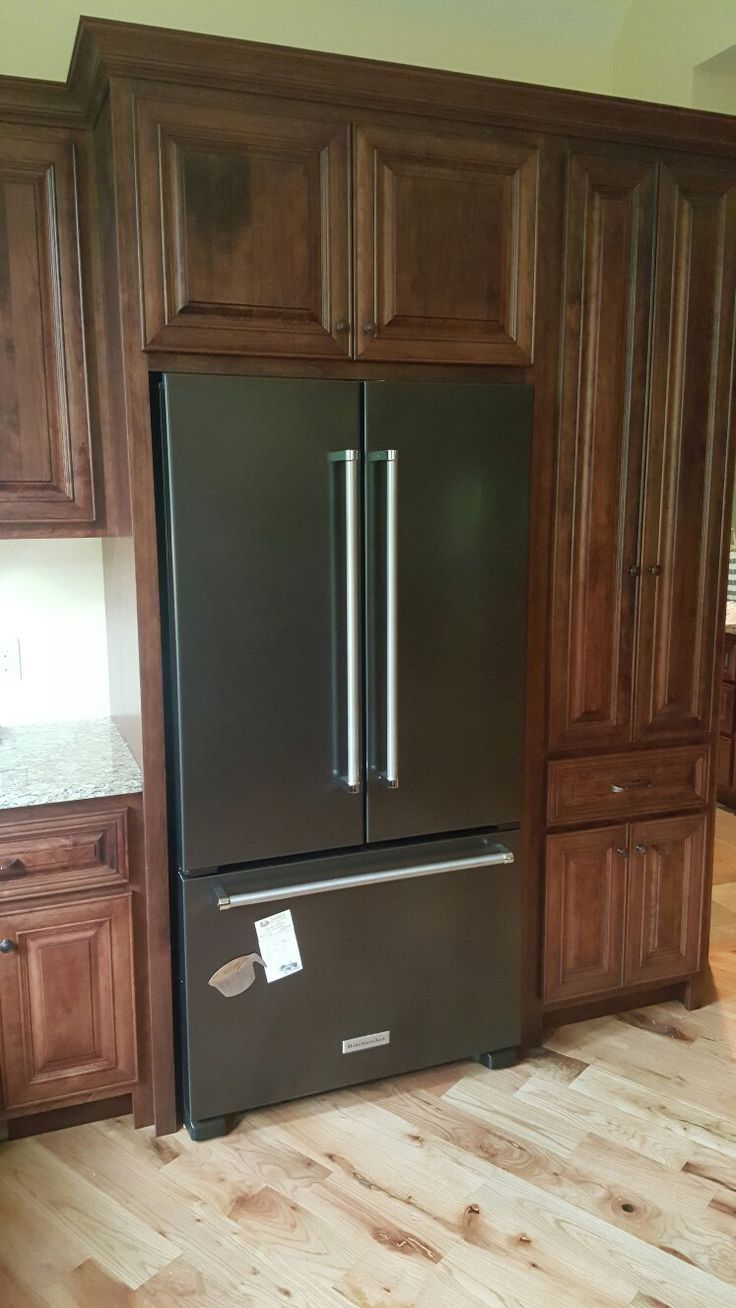 Kitchenaid black stainless appliances with cherry cabinets for Brown kitchen cabinets with black appliances