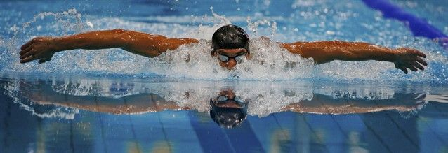 Phelps swims during the men's 400m individual medley final at the London 2012 Olympic Games. 7.28.2012