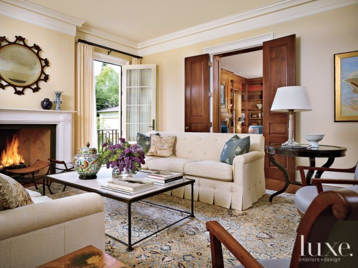 The Living Room Holds A Pair Of Custom Tufted And Skirted Sofas Dressed In  Glant Fabric