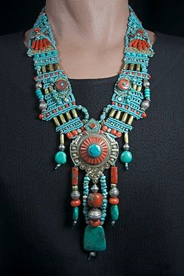 Necklace | Barbara Natoli Witt.  Antique Tibetan silver pendant set with coral, turquoise, and bronze combined with antique Tibetan silver beads and turquoise beads, Italian red corals and old African bronze tribal beads
