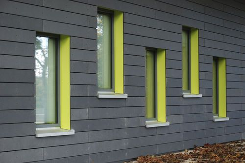 Rivestimento di facciata in fibra di vetro / in cemento armato / con scanalature / in pannello ÖKO SKIN - LIQUIDE BLACK Rieder Smart Elements GmbH
