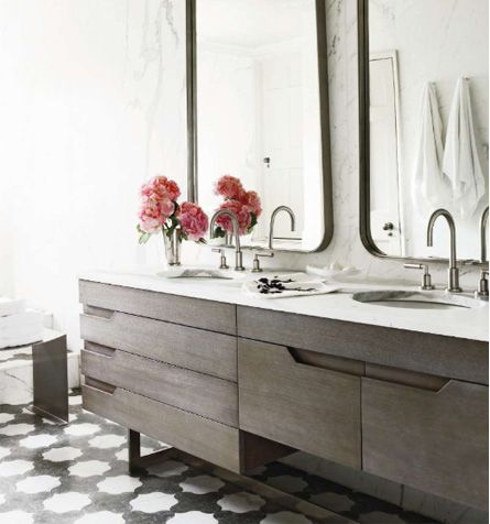 bathroom with dark wooden cabinets and bright white lighting