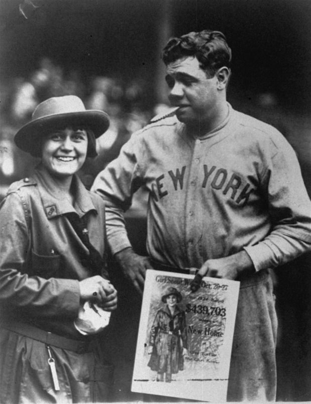 """Babe Ruth promoting Girl Scout Cookies (there's one in his mouth), 1923. Photo courtesy of The Dallas Morning News.     Note:  """"I thought that cookie was a cigar, I never saw a girl scout cookie that big."""" — Todd"""