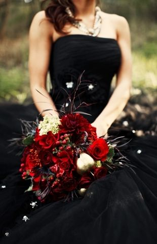 A black wedding gown and a blood-red rose bouquet bring the drama