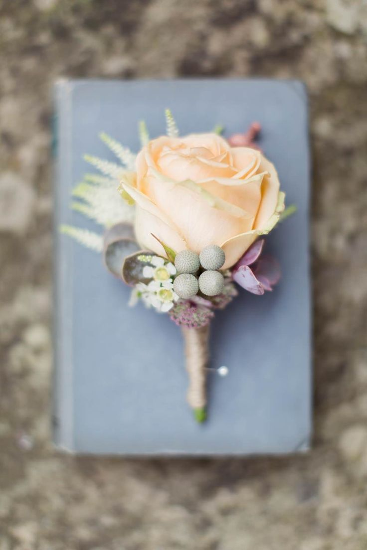 Peach rose buttonhole - Image by Craig & Eva Sanders Photography - Bride in a Bespoke Gown with Gold Christian Louboutin Shoes, for an outdoor humanist ceremony in Wales with pastel colour scheme & copper hints.