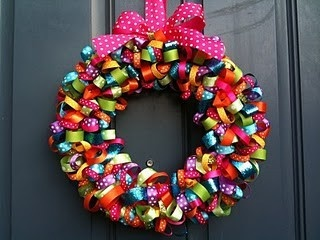 I really love these ribbon wreaths http://bit.ly/H7AyQT