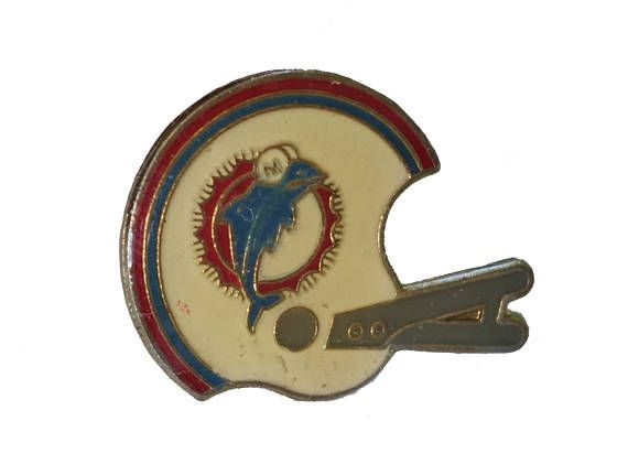 """MIAMI DOLPHINS Helmet Logo vintage enamel pin badge nfl Football Florida by VintageTrafficUSA  14.00 USD  A vintage Miami pin! Excellent condition. Measures: approx 1"""" These rare pins are proven to win you friends and influence people! Add inspiration to your handbag tie jacket backpack hat or wall. 20 years old hard to find vintage high-quality cloisonne lapel/pin. Beautiful die struck metal pin with colored glass enamel filling. -------------------------------------------- SECOND ITEM…"""