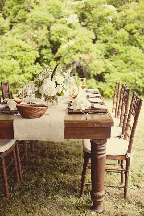 Beautiful tablescape! (I like the feathers tucked in with the hydrangea blooms)