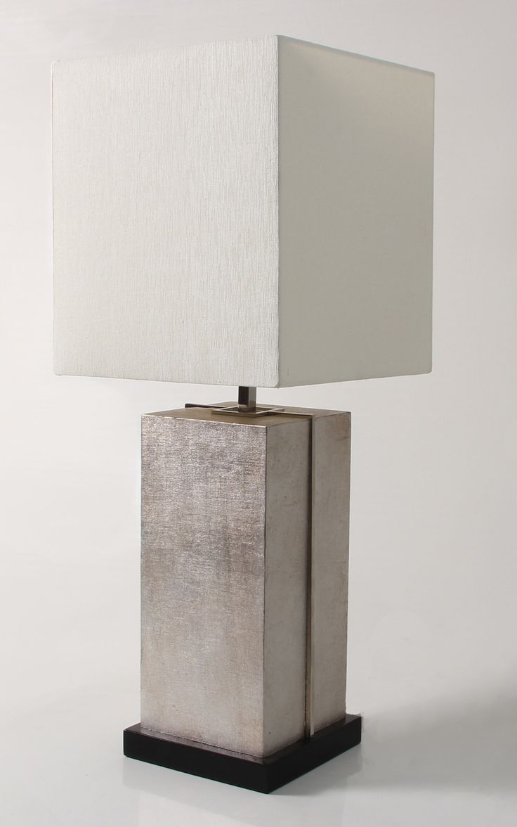 The Larken lamp is a stylish table lamp design made from stainless steel and antiqued silver faux linen. It comes with a light cream silk sharp corner square lampshade.