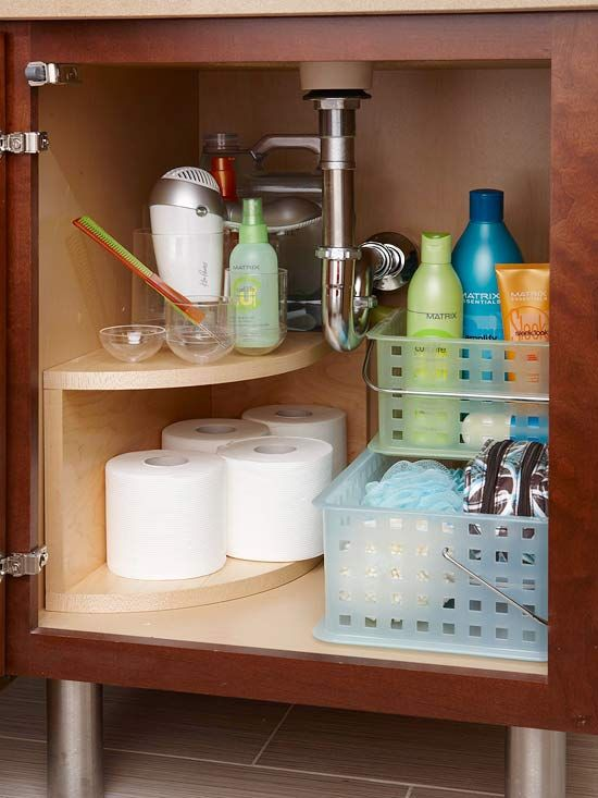 Storage packed bathroom remodel storage bins under sink and corner cabinets Bathroom corner cabinet storage