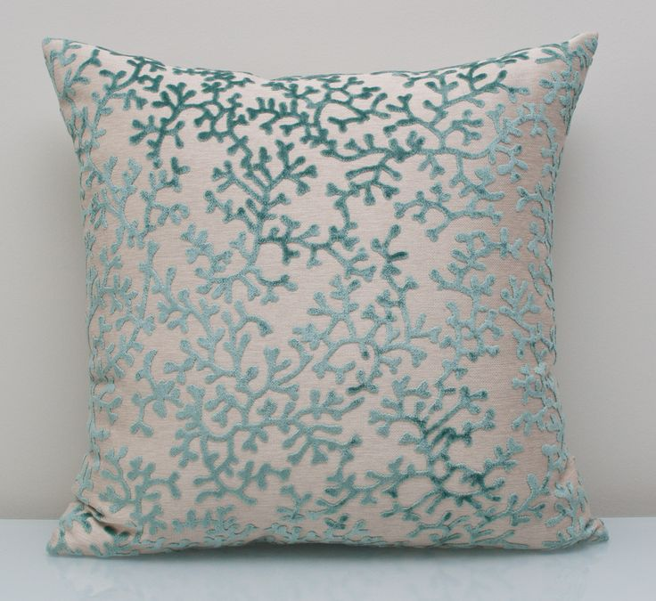 Blue pillow available at  threadsandmore.ca An opulent coral patterned pillow belonging to a palette born of rain and wind can bring such calm and repose to a room. The greyish blue shade will cool down your sunny space and provide a contemporary look. FREE customization available