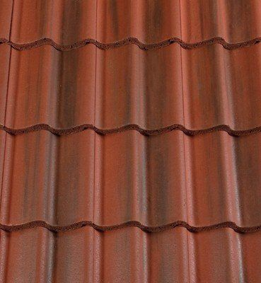 Low pitch Redland Grovebury roof tiles – Roofing Outlet. Rustic Red colour. Can be used down to 15°