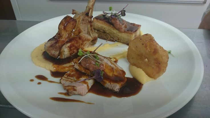 Pork rack, pork belly, swede puree, apple fritter, honey and thyme jus.