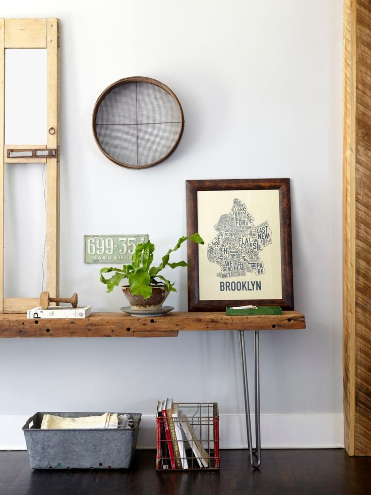 #DIY a console table with a plank of rugged wood and midcentury-style hairpin legs, as seen in #hgtvmagazine. http://www.hgtv.com/design/decorating/design-101/19-ways-to-add-character-to-your-house-pictures?soc=pinterest