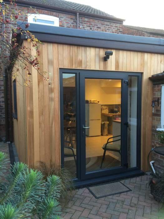 The 25 best cedar cladding ideas on pinterest cedar for Cedar clad garage doors
