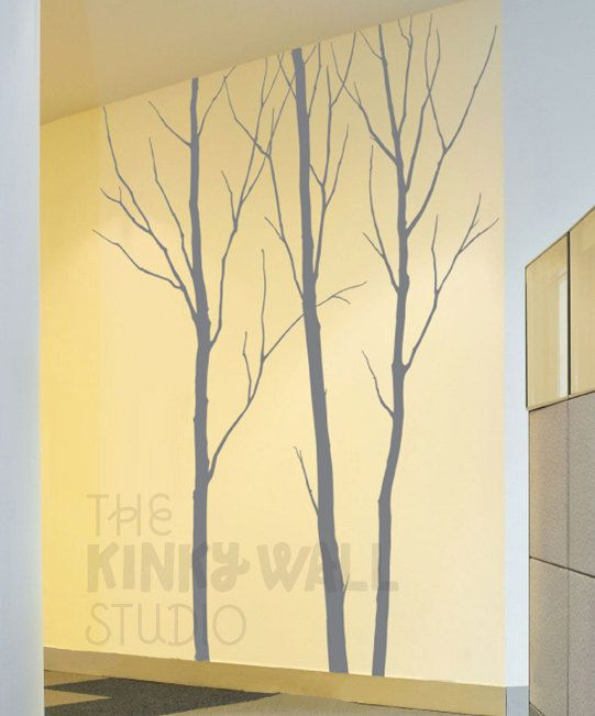 yellow wall, grey trees. perfect.