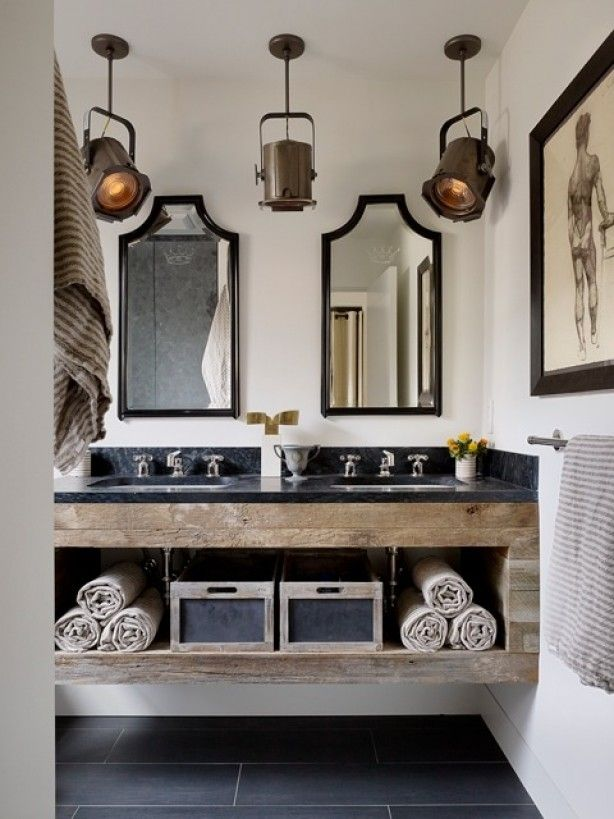 I love the lights. And the bronze tone, barn wood vanity and off-white linens temper the crisp white walls, black trim, and black marble countertop.