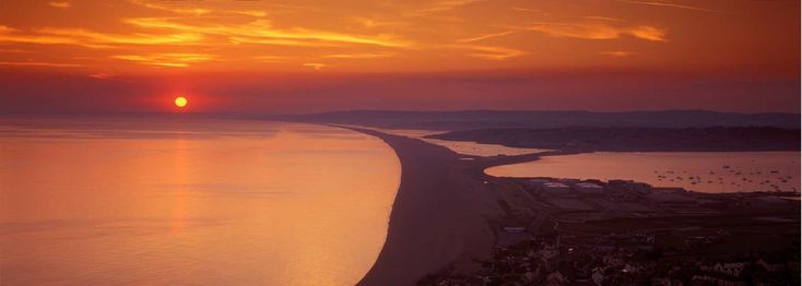 Sit back and enjoy the spectacular sunset over Chesil Beach