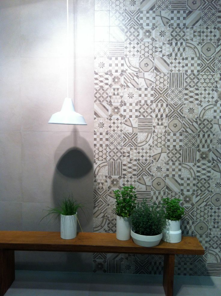 MARAZZI _ Tile effect of resin Block collection by Marazzi left of the image. On the right, lining in imitation of cement tiles. www.marazzi.it