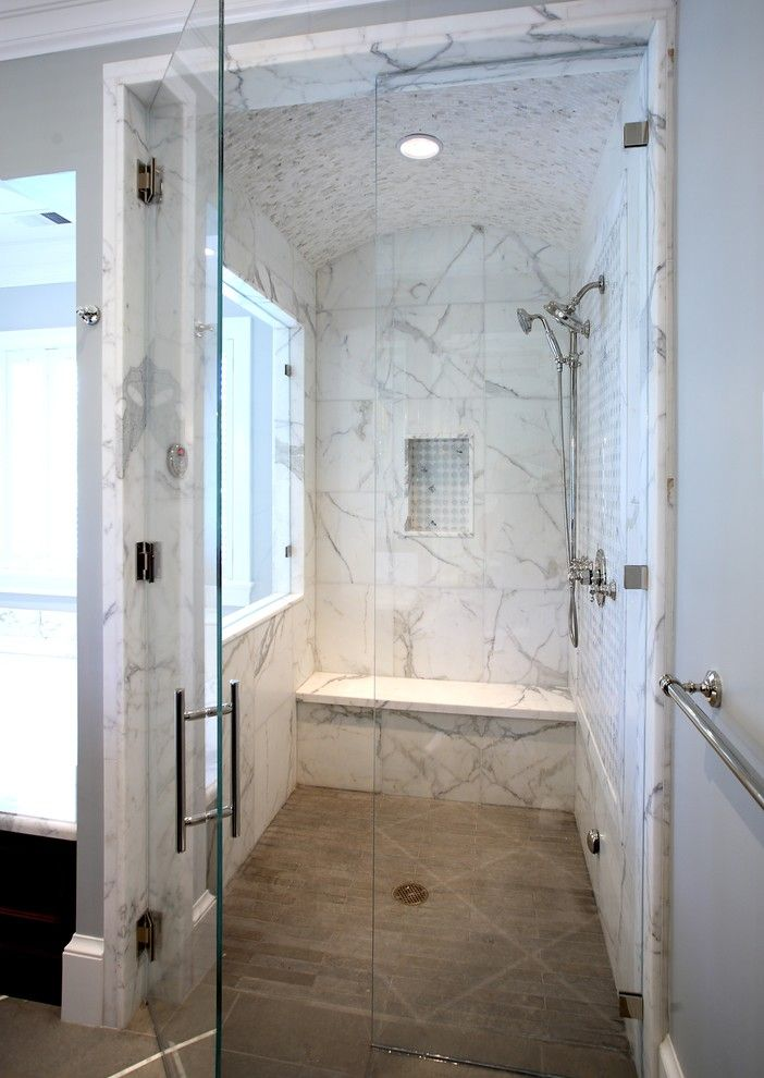 Contemporary Marble Tiled Walk-In Shower Design with Seating