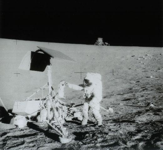 November 20, 1969: 1969: Apollo 12 astronaut Alan Bean grasps the Surveyor 3 TV camera (on Moon since 4/20/67) to return it to Earth. Photo credit: NASA: Apollo 12, Apollo12, Pete Conrad, Lunar Surface, Beans, Camera, November 20, Photo, The Moon