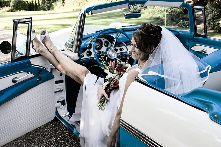 Beautiful bride relaxing in daddy's vintage Ford Sunliner